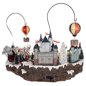 Christmas village with hot air balloons and track for cars 30x65x40 cm s5