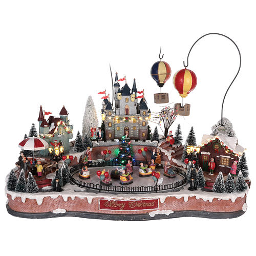 Christmas village with hot air balloons and track for cars 30x65x40 cm 1