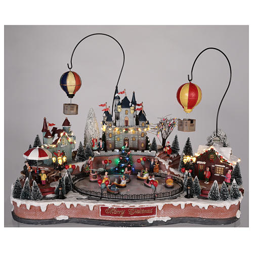 Christmas village with hot air balloons and track for cars 30x65x40 cm 2
