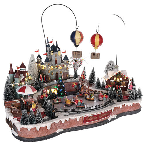 Christmas village with hot air balloons and track for cars 30x65x40 cm 4
