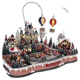 Christmas village with hot air balloons and ice rink 30x65x40 cm s4