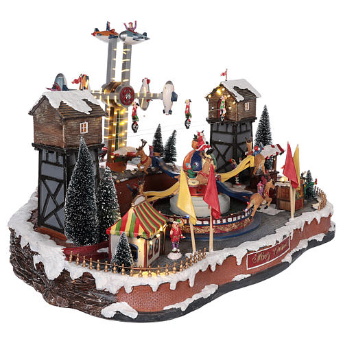 Christmas park with airplanes and merry-go-rounds with reindeer 45x65x45 cm 4