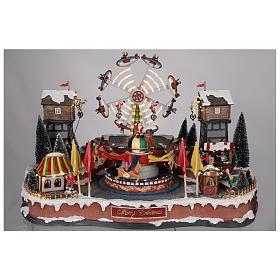 Fête foraine Noël avec avions funambules et carrousel 45x65x45 cm s2
