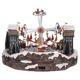 Fête foraine Noël avec avions funambules et carrousel 45x65x45 cm s5