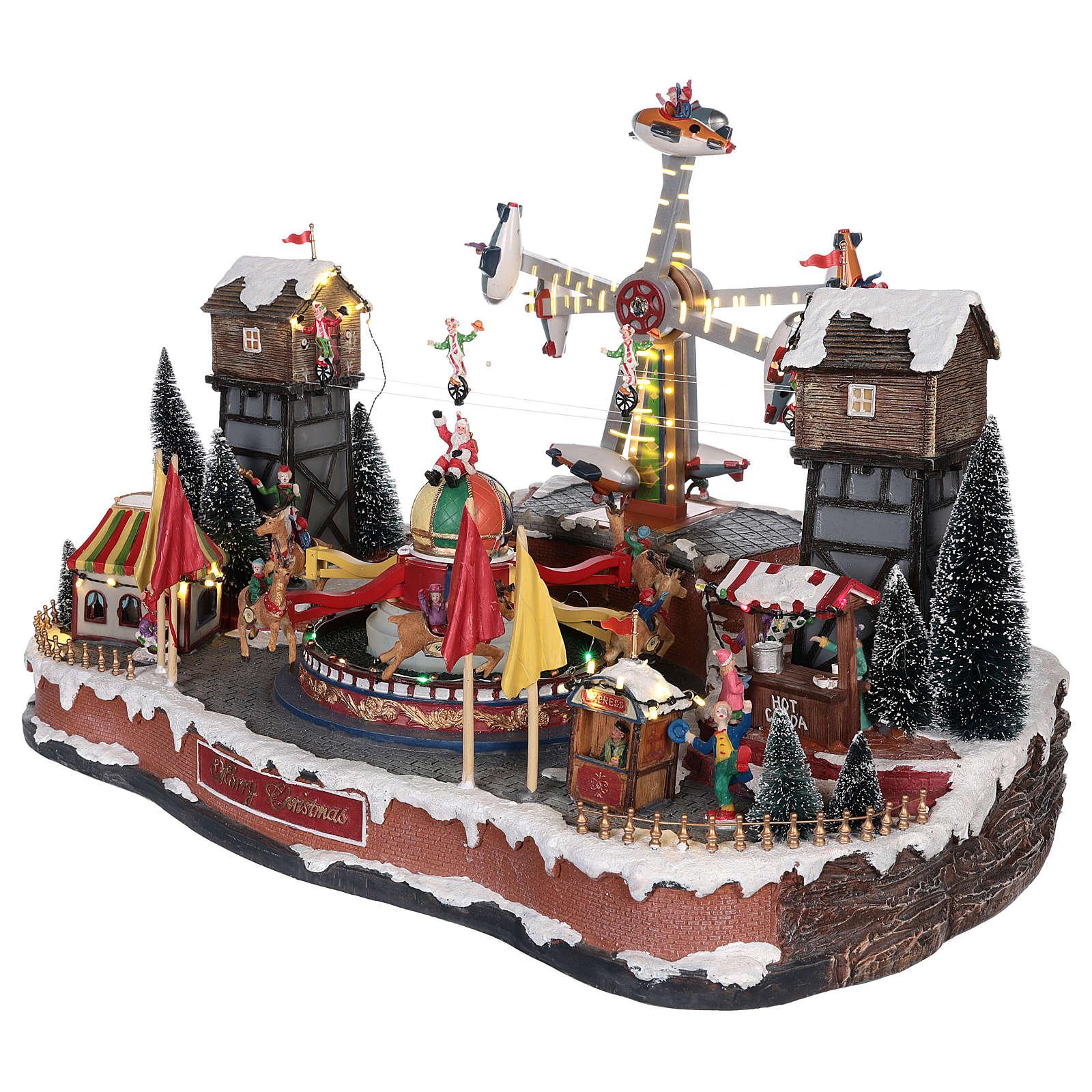 Luna park natalizio con aeroplani funamboli e giostra 45x65x45 cm 3