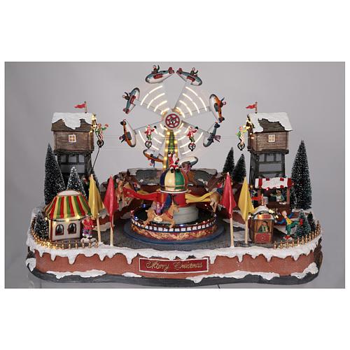 Luna park natalizio con aeroplani funamboli e giostra 45x65x45 cm 2