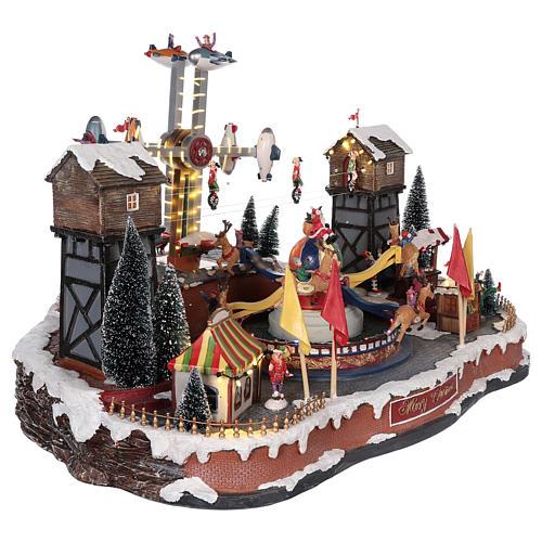 Luna park natalizio con aeroplani funamboli e giostra 45x65x45 cm 4