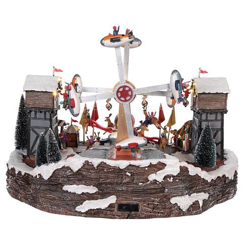 Luna park natalizio con aeroplani funamboli e giostra 45x65x45 cm 5