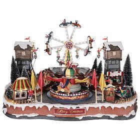 Cenários Natalinos em Miniatura: Parque de diversão com aviões funâmbulos e carrossel 45x65x45 cm