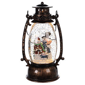 Snowball with family of puppets inside a 25x10 cm lantern s1