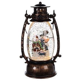 Globo de neve com bonecos de neve numa lanterna 25x10 cm s1