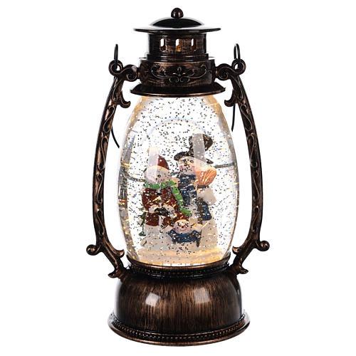 Globo de neve com bonecos de neve numa lanterna 25x10 cm 1