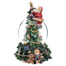 Bola de nieve con Papá Noel y árbol de navidad h 20 cm s1