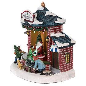 Pueblo de Navidad con Papá Noel y tienda de árboles 20x20x20 cm s3