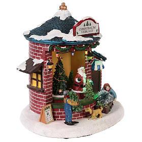 Pueblo de Navidad con Papá Noel y tienda de árboles 20x20x20 cm s4