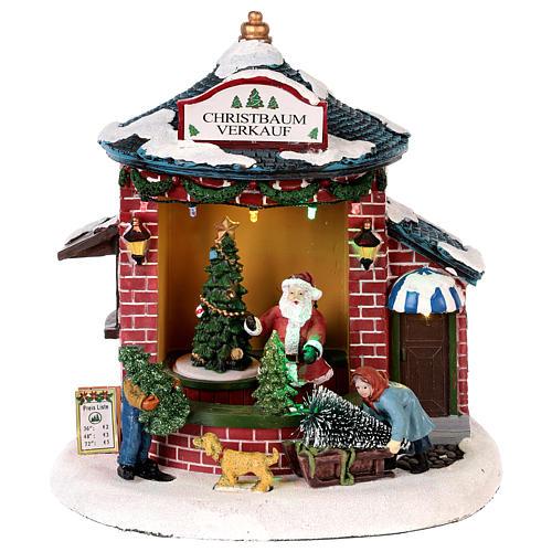 Pueblo de Navidad con Papá Noel y tienda de árboles 20x20x20 cm 1