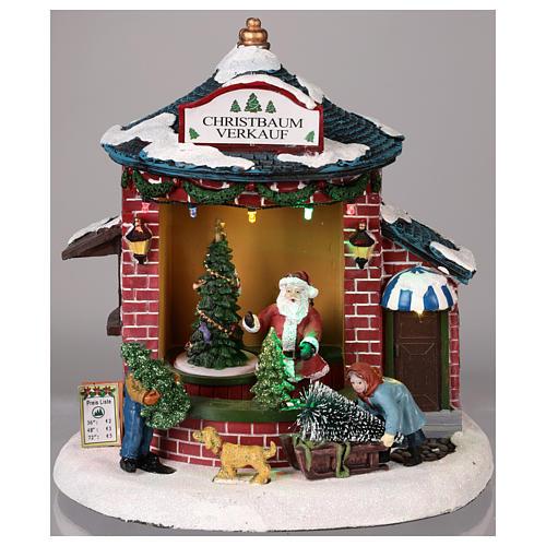 Pueblo de Navidad con Papá Noel y tienda de árboles 20x20x20 cm 2