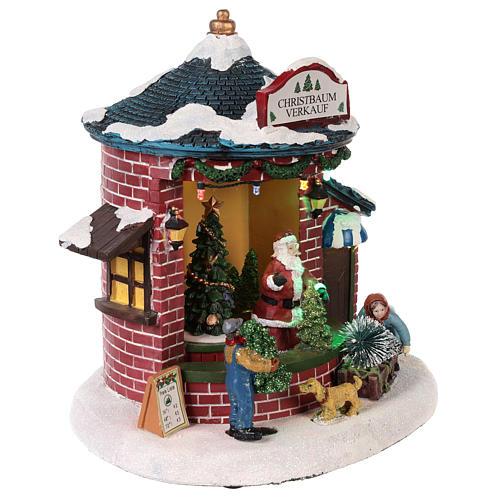 Pueblo de Navidad con Papá Noel y tienda de árboles 20x20x20 cm 4