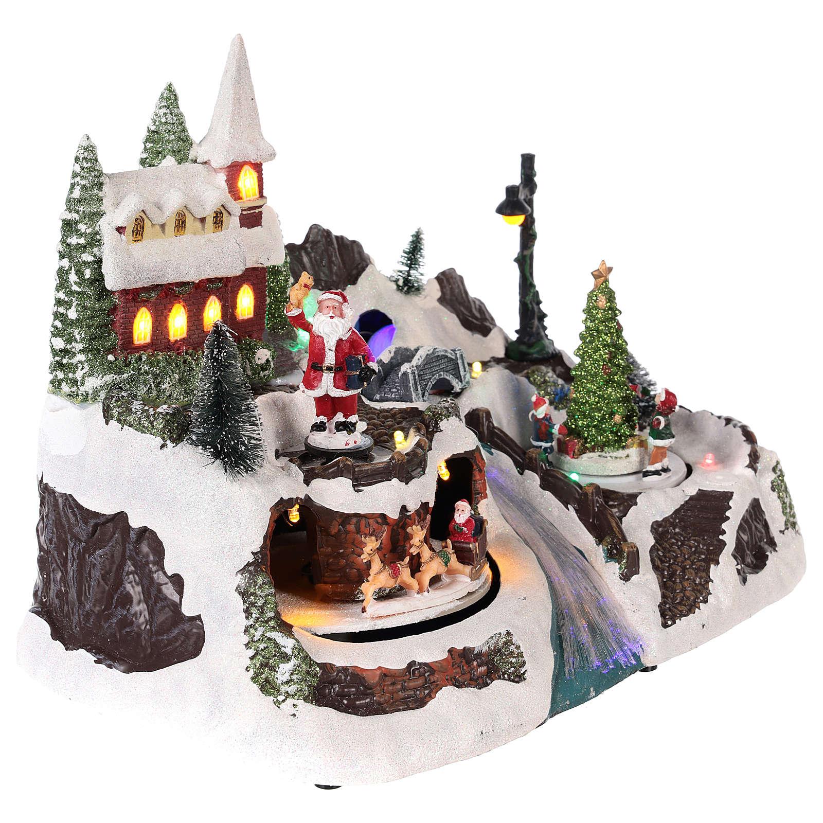 Pueblo con Papá Noel y niños en movimiento 20x30x20 cm 3