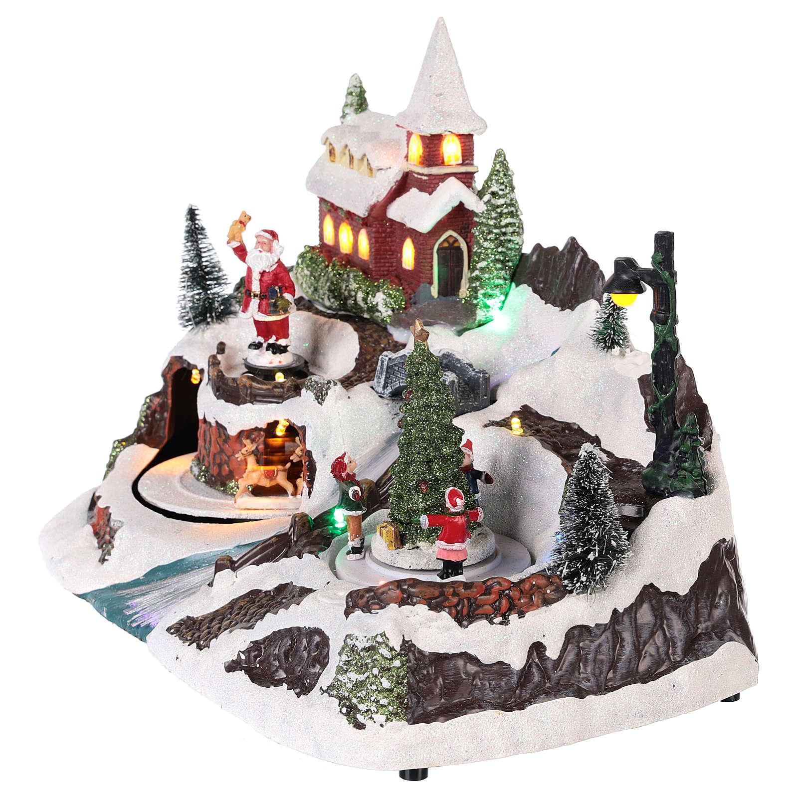 Village avec Père Noël et enfants en mouvement 20x30x20 cm 3