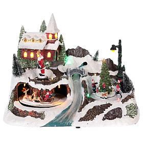Villages de Noël miniatures: Village avec Père Noël et enfants en mouvement 20x30x20 cm