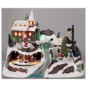 Village avec Père Noël et enfants en mouvement 20x30x20 cm s2