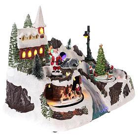 Village avec Père Noël et enfants en mouvement 20x30x20 cm s4