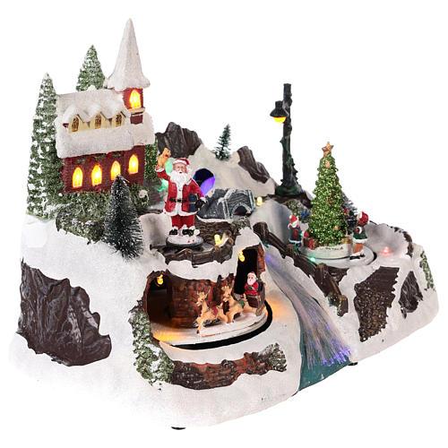 Village avec Père Noël et enfants en mouvement 20x30x20 cm 4