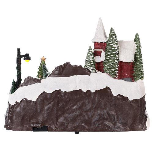 Village avec Père Noël et enfants en mouvement 20x30x20 cm 5