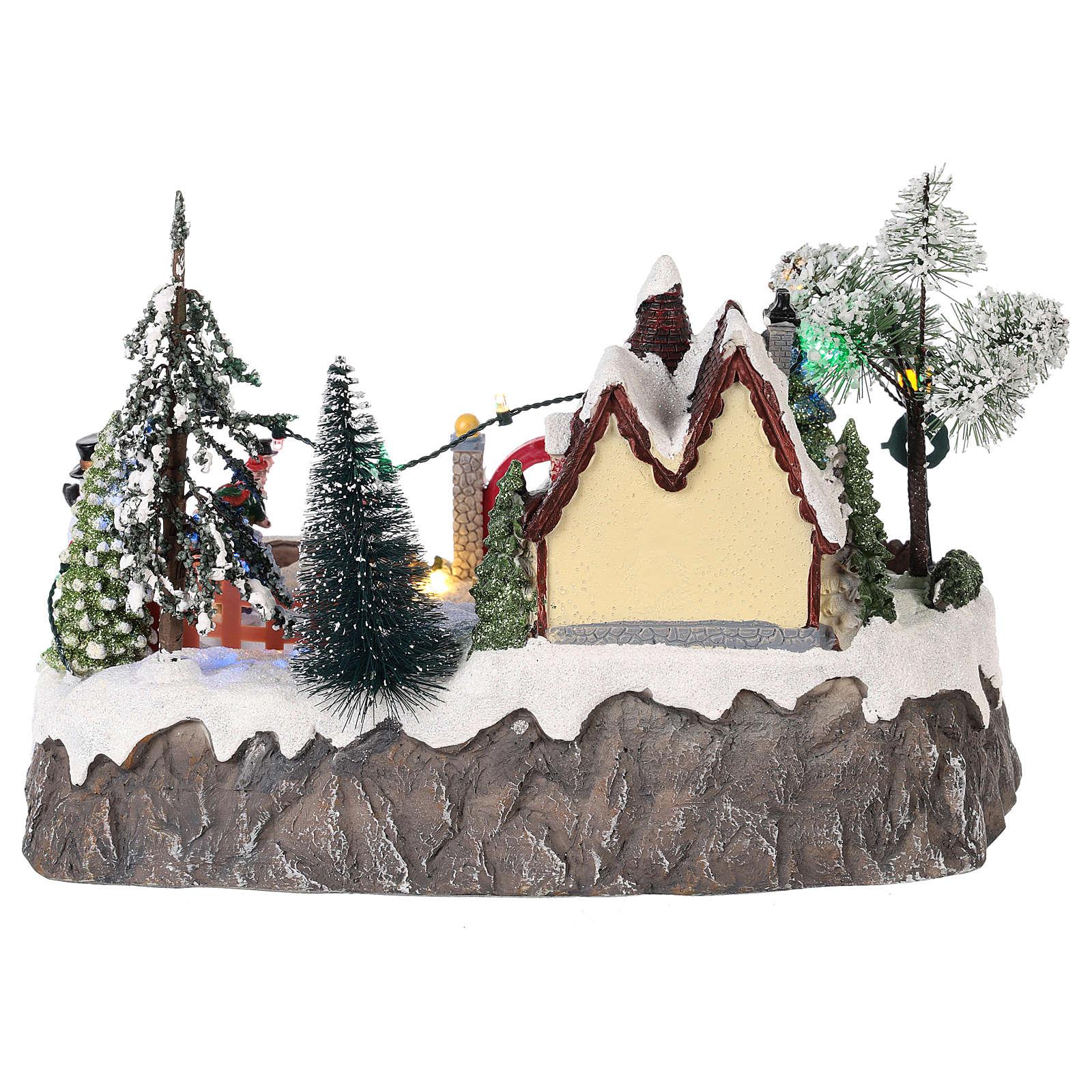 Pueblo de navidad con movimiento y luces 20x30x20 cm 3