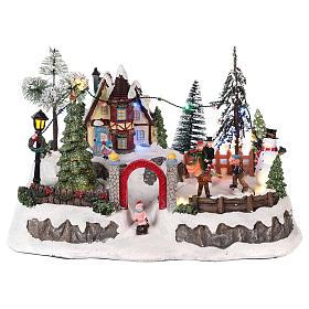 Pueblo de navidad con movimiento y luces 20x30x20 cm s1