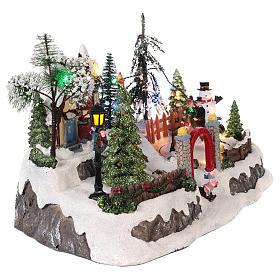 Pueblo de navidad con movimiento y luces 20x30x20 cm s4