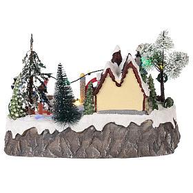 Pueblo de navidad con movimiento y luces 20x30x20 cm s5