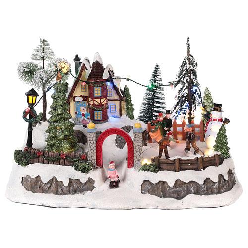 Pueblo de navidad con movimiento y luces 20x30x20 cm 1