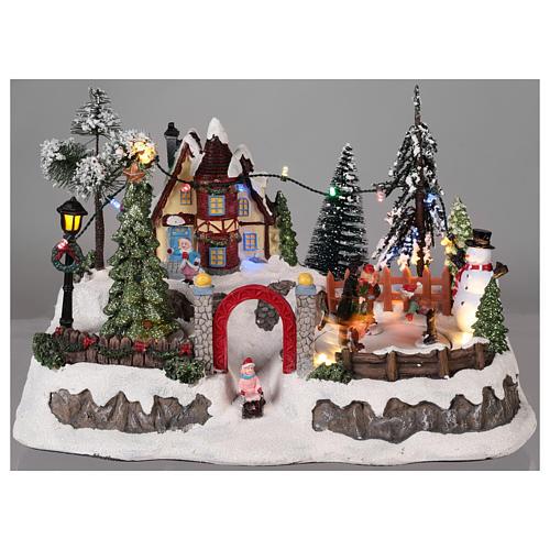 Pueblo de navidad con movimiento y luces 20x30x20 cm 2