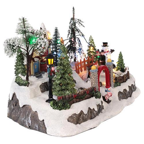 Pueblo de navidad con movimiento y luces 20x30x20 cm 4