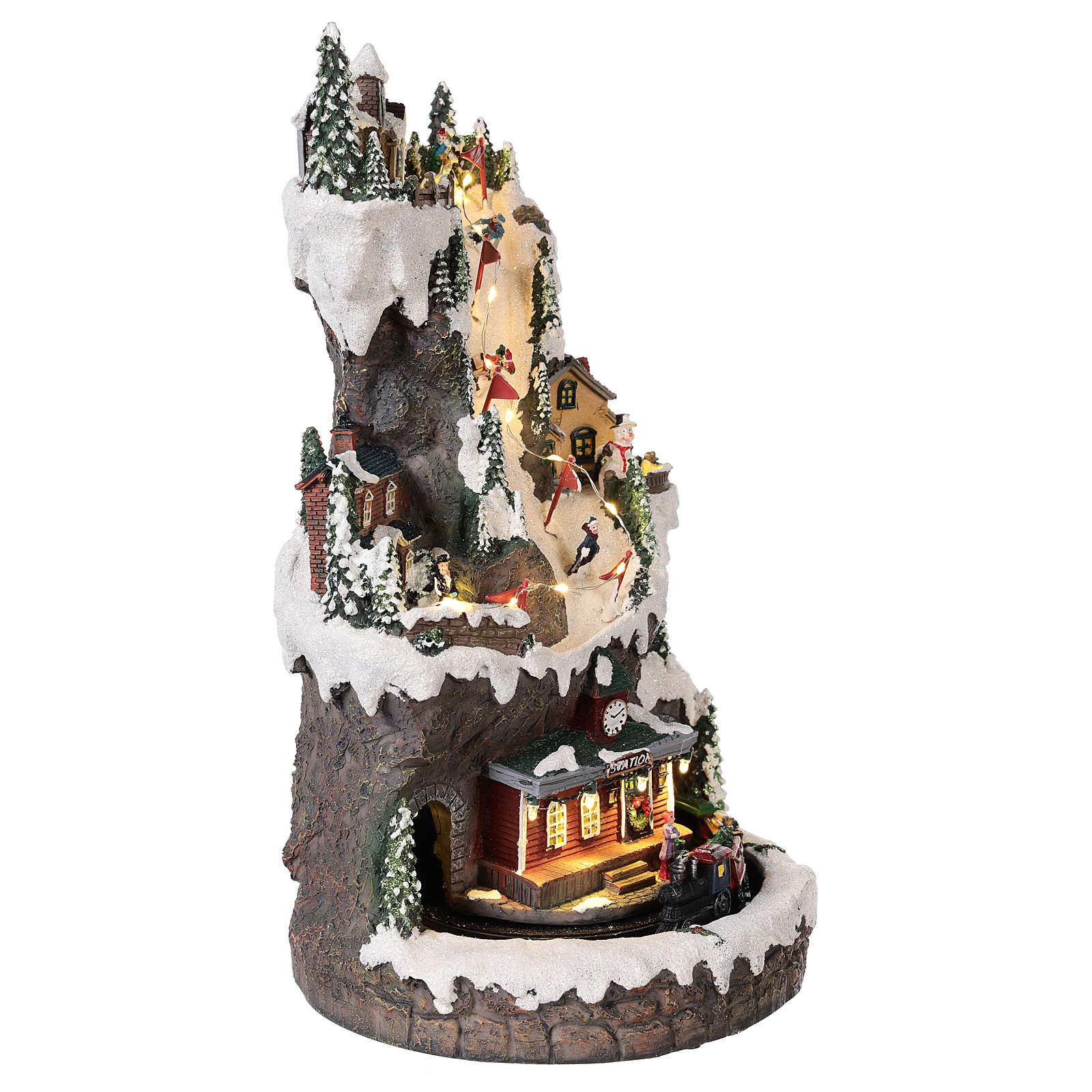 Villaggio natalizio 30x20x20 cm con luci e treno in movimento 3