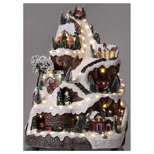 Pueblo navideño montaña iluminado con música 45x30x30 cm 2