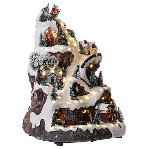 Pueblo navideño montaña iluminado con música 45x30x30 cm 4