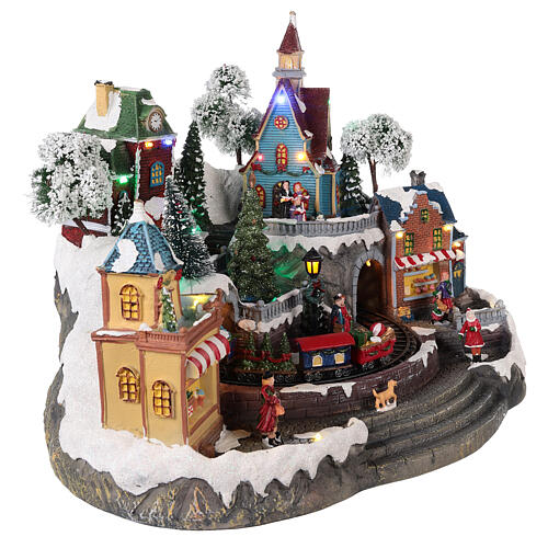 Animated Christmas village with train 35x45x35 cm 4