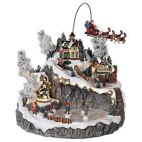 Villaggio natalizio slitta renna pattinatori movimento luci musica 40x45x35 s1