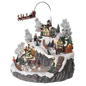 Villaggio natalizio slitta renna pattinatori movimento luci musica 40x45x35 s3