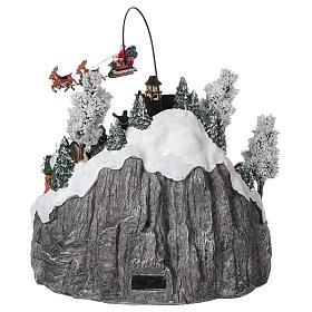 Villaggio natalizio slitta renna pattinatori movimento luci musica 40x45x35 s5