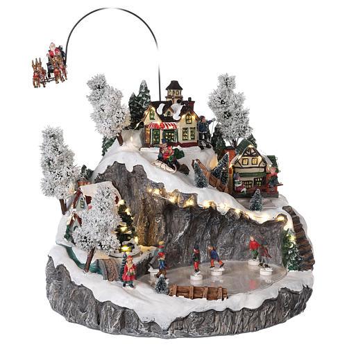 Villaggio natalizio slitta renna pattinatori movimento luci musica 40x45x35 4