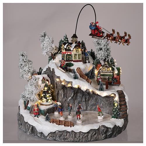 Christmas village reindeer sleigh ice skaters movement lights music 2