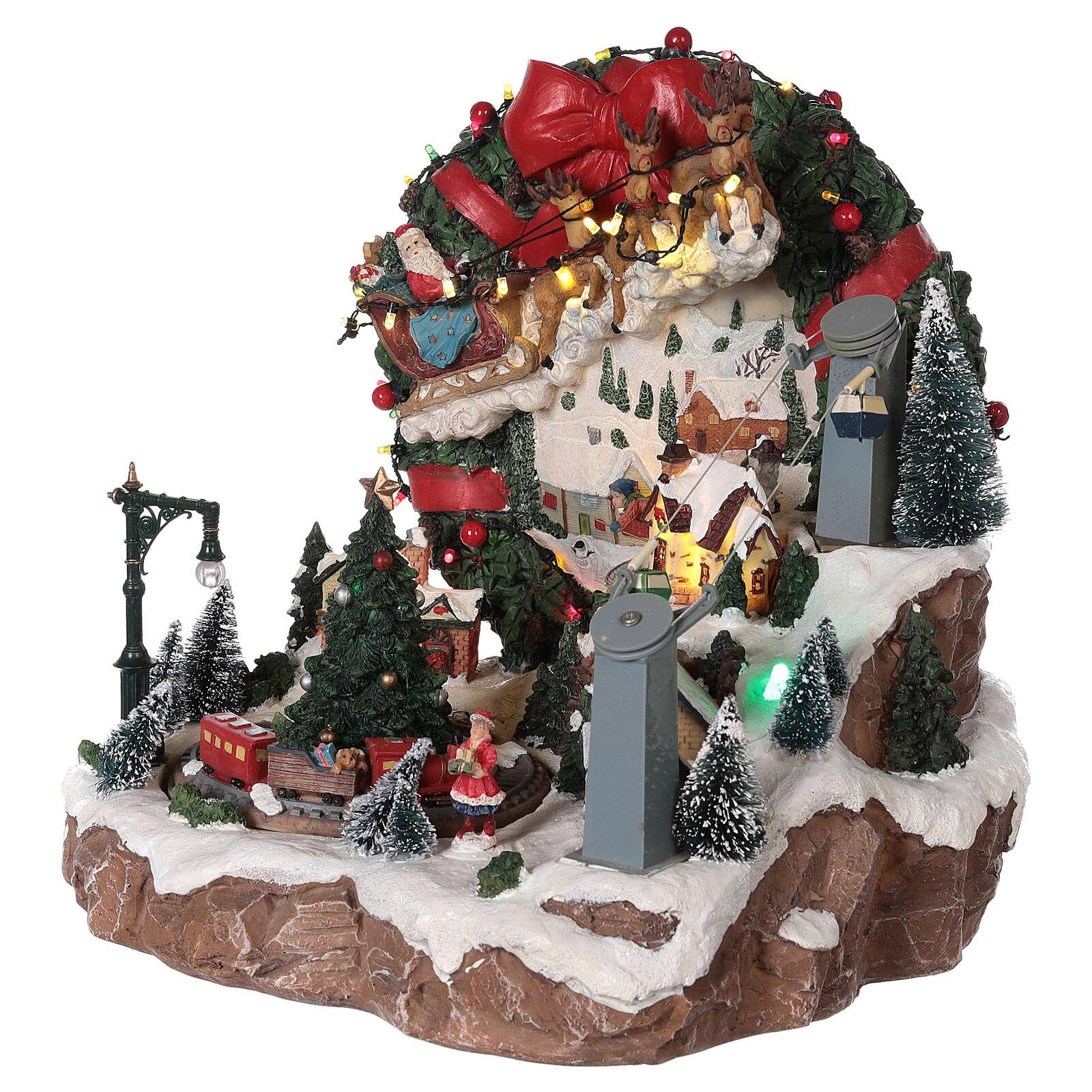 Weihnachtsdorf mit Weihnachtsmann und Rentierschlitten, 30x30x30 cm 3