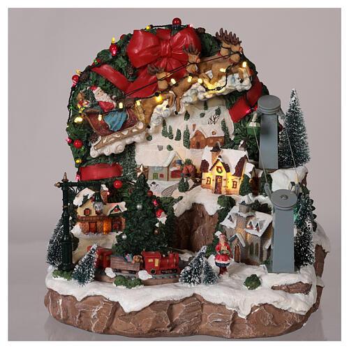 Weihnachtsdorf mit Weihnachtsmann und Rentierschlitten, 30x30x30 cm 2