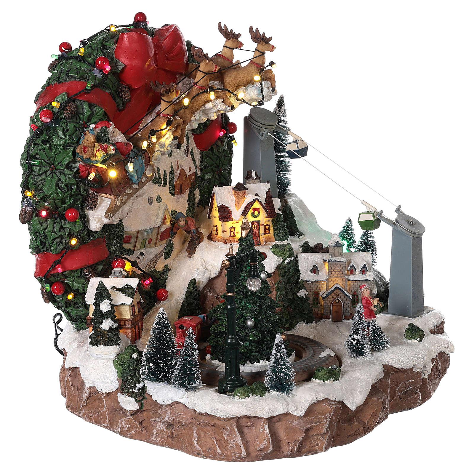 Pueblo de Navidad trineo reno teleférico movimiento luces música 30x30x30 cm 3