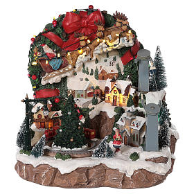 Villages de Noël miniatures: Village de Noël traineau renne téléphérique mouvement lumières musique 30x30x30 cm