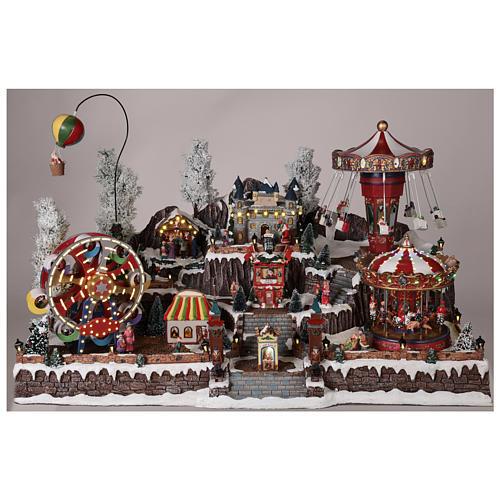 Pueblo navideño atracciones castillo movimiento luces 55x85x55 cm 2